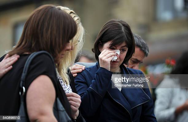 Lucy Powell MP for Manchester Central wipes away tears as people gather to leave flowers and tributes in Market Square in memory of Jo Cox Labour MP...