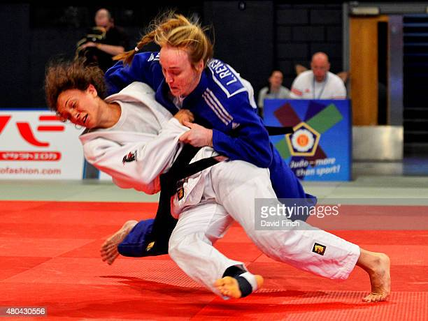 Lucy Renshall of Great Britain throws Giorgia Dalla Corte of Italy for ippon as she advanced to the u63kg final and the silver medal during the 2015...