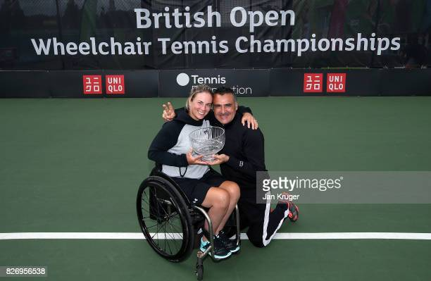 Lucy Shuker of Great Britain and Stephane Houdet of France pose with the mixed doubles winning trophy during the British Open Wheelchair Tennis at...