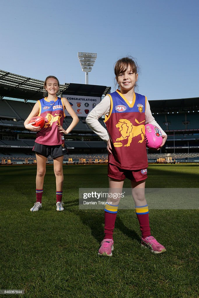 Lucy Slobom and Ella Grimsey pose for a photo wearing Brisbane Lions jumpers during an AFL media opportunity to announce the competing teams in next year's inaugural Women's National League at Melbourne Cricket Ground on June 15, 2016 in Melbourne, Australia.