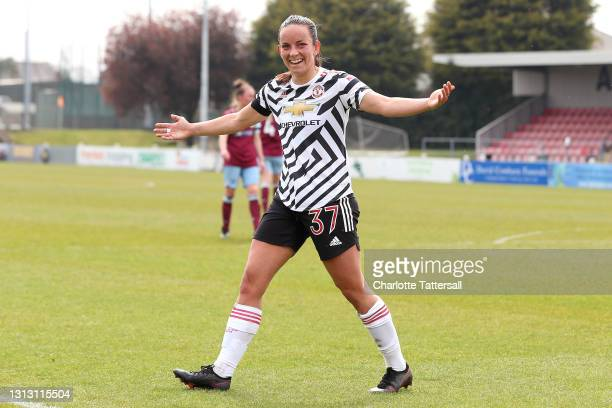 Lucy Staniforth of Manchester United celebrates after scoring her team's third goal during the Vitality Women's FA Cup match between Burnley Women...