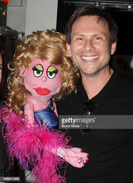 Lucy The Slut and Christian Slater pose backstage at the hit musical Avenue Q on Broadway at The New World Stages on May 12 2013 in New York City