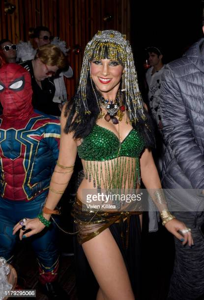 Lucy Walsh attends Podwall Entertainment's 10th Annual Halloween Party presented by Maker's Mark on October 31 2019 in West Hollywood California