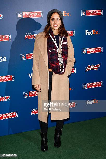 Lucy Watson attends as the Dallas Cowboys play the Jacksonville Jaguars in an NFL match at Wembley Stadium on November 9 2014 in London England
