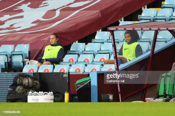 Lucy Whipp and Destiny Toussaint of Birmingham look on from the sidelines during the Barclays FA Women's Super League match between Aston Villa Women...