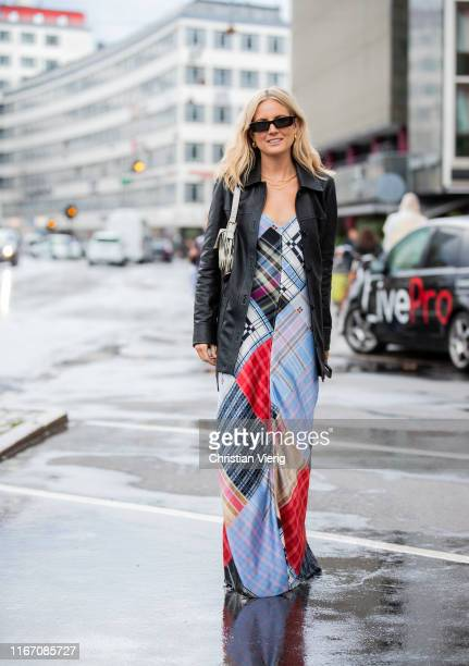 Lucy Williams seen wearing leather jacket multi colored dress wth mixed pattern outside Ganni during Copenhagen Fashion Week Spring/Summer 2020 on...