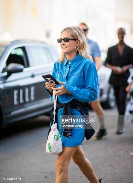 Lucy Williams wearing blue denim button shirt worn as a dress seen outside Ganni during the Copenhagen Fashion Week Spring/Summer 2019 on August 9...