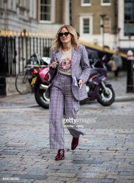 Lucy Williams wearing checked suit outside Emilia Wickstead during London Fashion Week September 2017 on September 18 2017 in London England