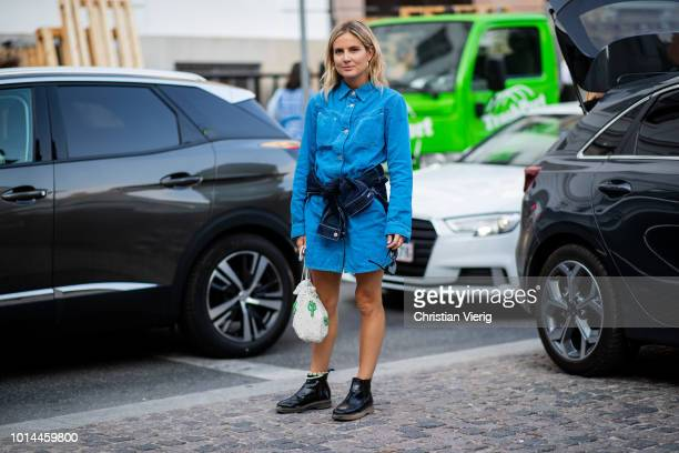 Lucy Williams wearing denim dress button shirt is seen outside Baum und Pferdgarten during the Copenhagen Fashion Week Spring/Summer 2019 on August 9...