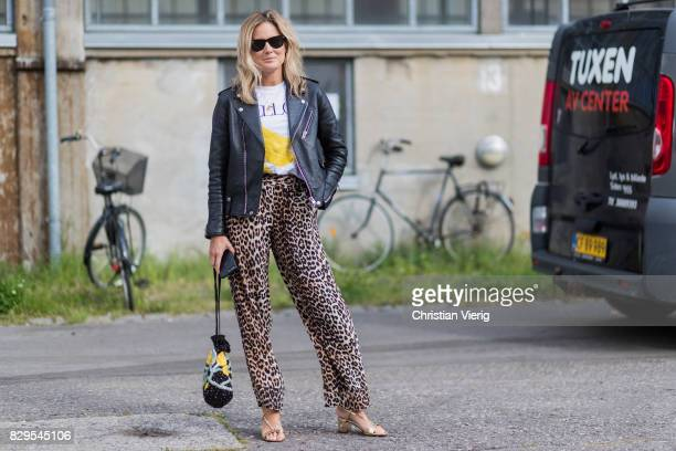 7e0179687e37 Lucy Williams wearing pants with leopard print leather jacket outside Ganni  on August 10 2017 in