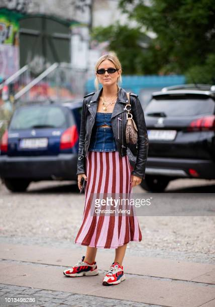 Lucy Williams wearing red pink striped skirt, Dior saddle bag, leather jacket is seen outside Stine Goya during the Copenhagen Fashion Week...