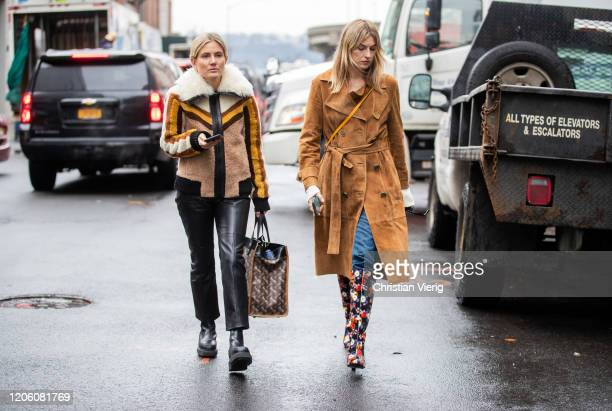 Lucy Williams wearing shearling jacket and Camille Charriere is seen wearing brown wild leather jacket outside Coach during New York Fashion Week...