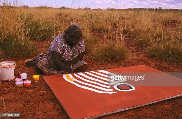 Lucy Yukenbarri painting Tjuriltjarra' a story map of the Great Western Desert in the open Balgo / Wirrimanu southeast Kimberley region Western...
