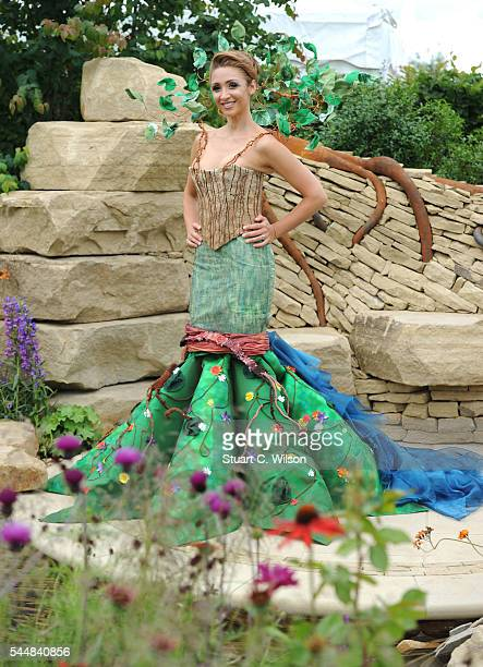 LucyJo Hudson poses in the Zoflora garden during the launch of the RHS Hampton Court Flower Show at Hampton Court Palace on July 4 2016 in London...