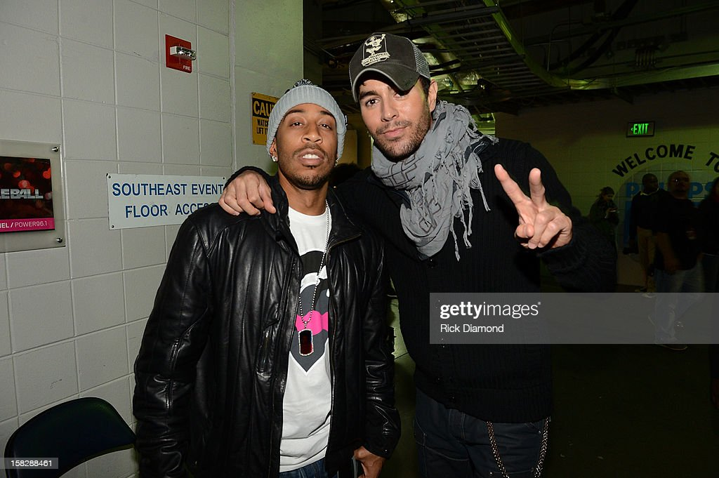 Ludacris and Enrique Iglesias pose backstage at Power 96.1's Jingle Ball 2012 at the Philips Arena on December 12, 2012 in Atlanta.
