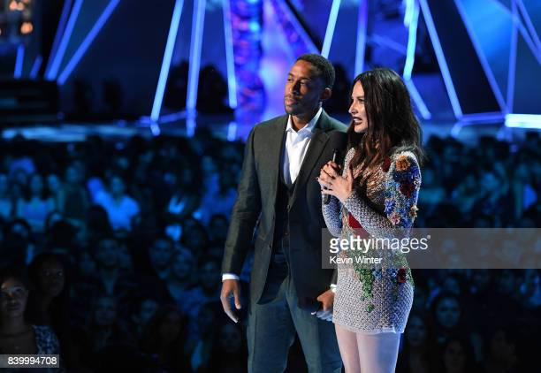 Ludacris and Olivia Munn speak onstage during the 2017 MTV Video Music Awards at The Forum on August 27 2017 in Inglewood California