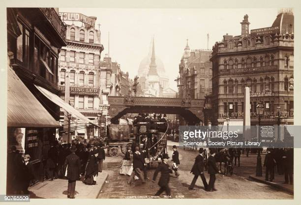 Ludgate Circus with the �King Lud� pub on the left a horsedrawn bus the centre and St Paul�s Cathedral in the distance Photograph from an album...