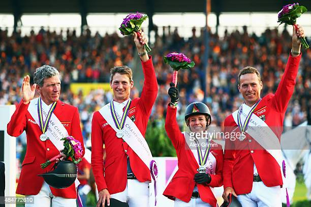 Ludger Beerbaum Daniel Deusser Meredith MichaelsBeerbaum and Christian Ahlmann of Germany celebrate finishing second in the MercedesBenz Prize Show...