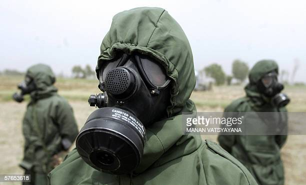 Indian army officers wear chemical protection suits as they perform a decontamination procedure during a military drill named Sanghe Shakti in the...