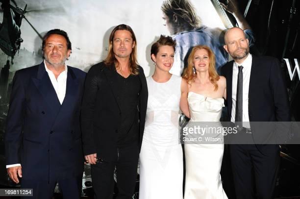 Ludi Boeken Brad Pitt Daniella Kertesz Mireille Enos and director Marc Forster attend the World Premiere of 'World War Z' at The Empire Cinema on...