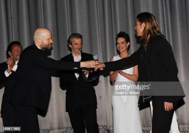 Ludi Boeken, Director Marc Forster, Peter Capaldi, Daniella Kertesz and Brad Pitt attend the World Premiere of 'World War Z' at The Empire Cinema on...