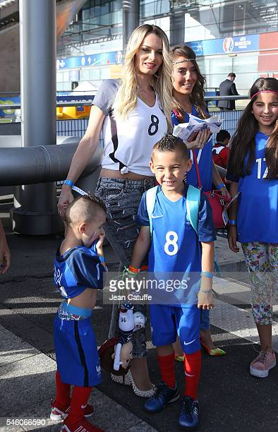 Ludivine Payet and her kids Noa Payet and Milan Payet attend the UEFA Euro 2016 final match between Portugal and France at Stade de France on July 10...