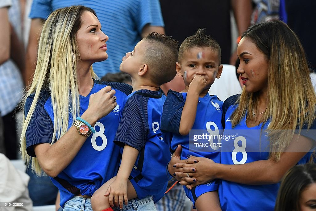 Ludivine Payet (L), the wife of France's forward Dimitri Payet, arrives for the start of the Euro 2016 semi-final football match between Germany and France at the Stade Velodrome in Marseille on July 7, 2016. FIFE