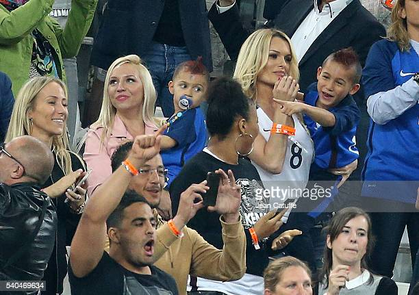 Ludivine Payet wife of Dimitri Payet and their two sons Noa Payet and Milan Payet celebrate Dimitri's goal during the UEFA EURO 2016 Group A match...