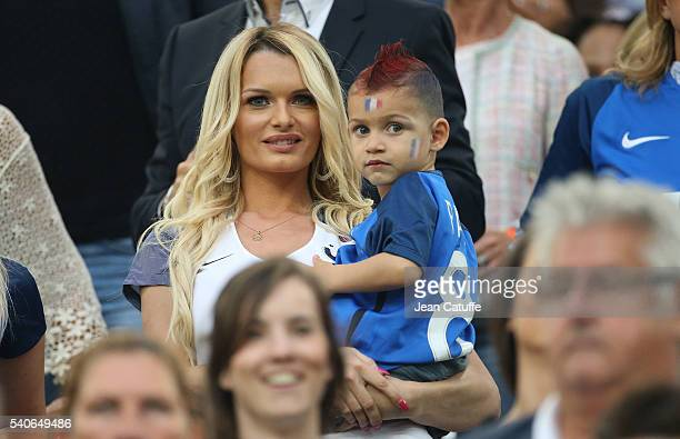 Ludivine Payet wife of Dimitri Payet of France and their son Milan Payet attend the UEFA EURO 2016 Group A match between France and Albania at Stade...