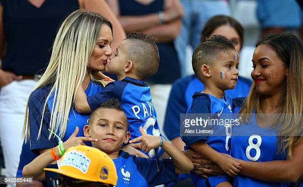 Ludivine Payet wife of Dimitri Payet of France kisses her child prior to the UEFA EURO semi final match between Germany and France at Stade Velodrome...