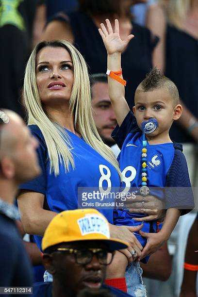Ludivine Payet wife of Dimitri Payet of France looks on with her child prior to the UEFA Euro 2016 Semi Final match between Germany and France at...