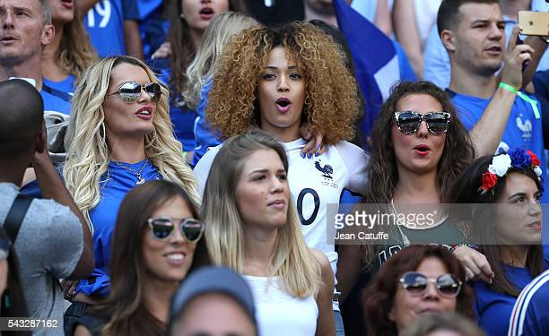 Ludivine Payet wife of Dimitri Payet Sephora Coman wife of Kingsley Coman and Tiziri Digne wife of Lucas Digne sing 'la Marseillaise' before the UEFA...
