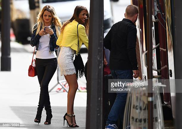 Ludivine Payet wife of France's forward Dimitri Payet walks past Camille Sold partner of France's midfielder Morgan Schneiderlin outside the French...