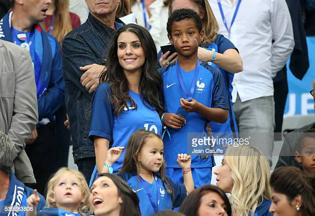 Ludivine Sagna wife of Bacary Sagna of France and their son Elias Sagna attend the UEFA Euro 2016 Group A opening match between France and Romania at...