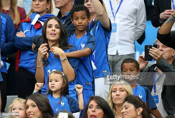 Ludivine Sagna wife of Bacary Sagna of France and their sons Elias Sagna and Kais Sagna attend the UEFA Euro 2016 Group A opening match between...