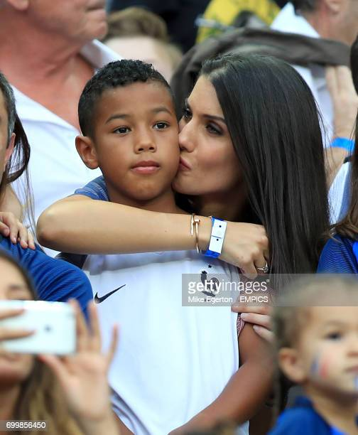 Ludivine Sagna wife of France's Bacary Sagna and their son Elias in the stands before the game