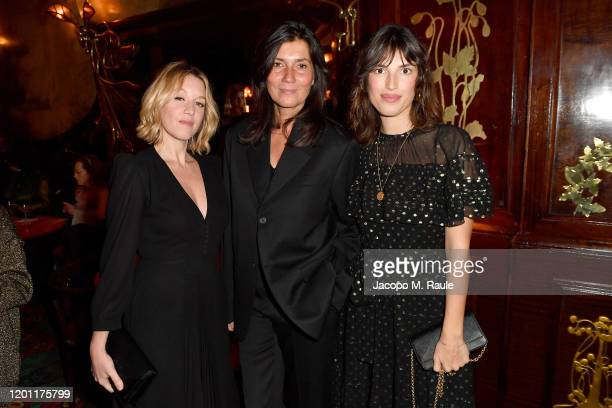 Ludivine Sagner Emmanuelle Alt and Jeanne Damas attend the dinner cohosted by Prada and Vogue Paris on January 19 2020 in Paris France