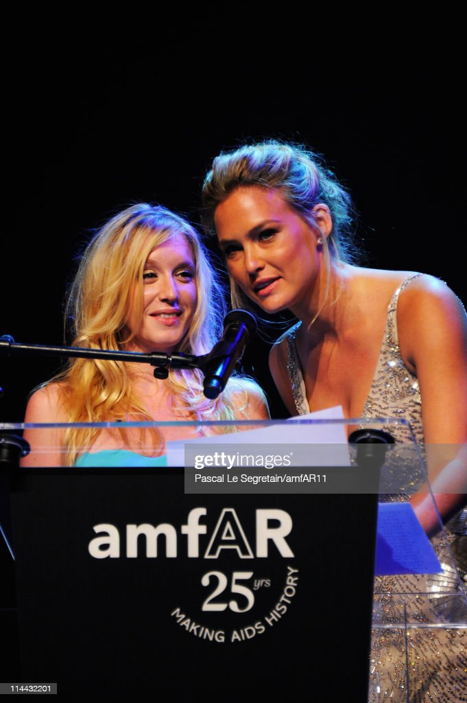 Ludivine Sagnier and Bar Refaeli onstage during amfAR's Cinema Against AIDS Gala during the 64th Annual Cannes Film Festival at Hotel Du Cap on May 19, 2011 in Antibes, France.