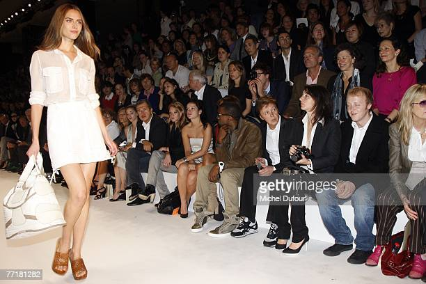 Ludivine Sagnier Lily Allen Kanye West and wife Paul McCartney with his children Mary and James attend the Stella McCartney fashion show during the...