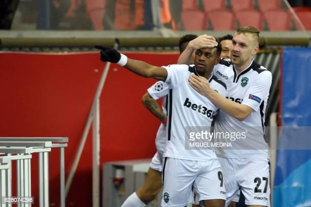 Ludogorets' Dutch forward Virgil Misidjan celebrates with Ludogorets Romanian defender Cosmin Moti after scoring a goal during the UEFA Champions...