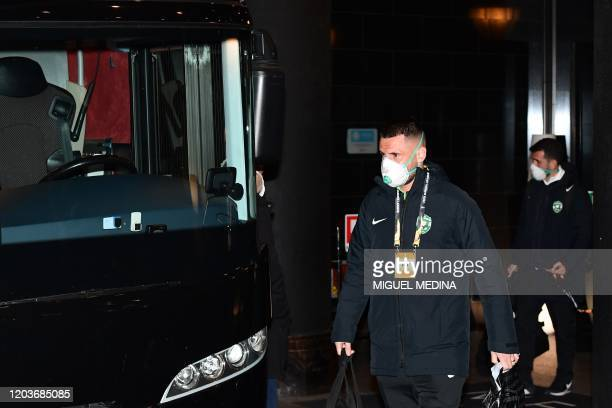 Ludogorets' players wear face masks as a safety measure against the COVID19 the novel coronavirus as they board the bus on their way to compete in...