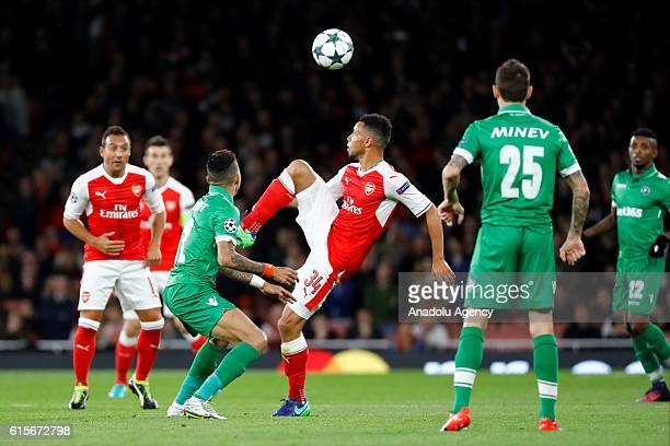 Ludogorets Razgrad's Anicet Abel vies with Arsenals Francis Coquelin during Champions League Group A match between Arsenal FC and Ludogorets Razgrad...