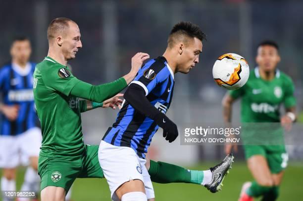Ludogorets Razgrad's Bulgarian defender Anton Nedyalkov fights for the ball with Inter Milan's Argentinian forward Lautaro Martinez during the UEFA...