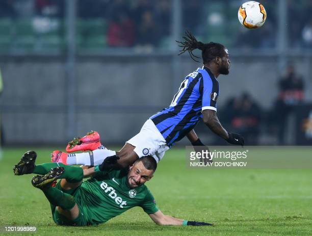 Ludogorets Razgrad's Bulgarian defender Georgi Ilkov Terziev fauls Inter Milan's Niferian midfielder Victor Moses during the UEFA Europa League round...