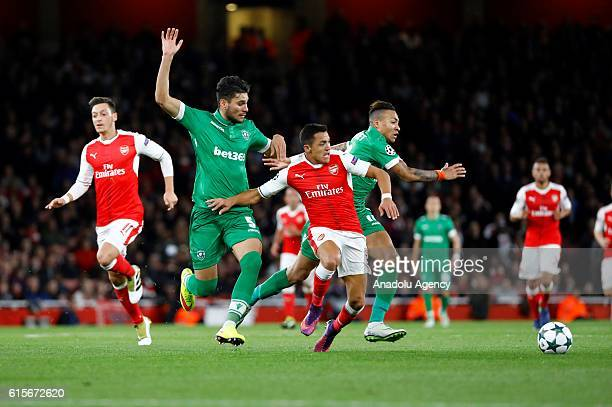 Ludogorets Razgrad's José Palomino vies with Arsenals Alexis Sánchez during Champions League Group A match between Arsenal FC and Ludogorets Razgrad...