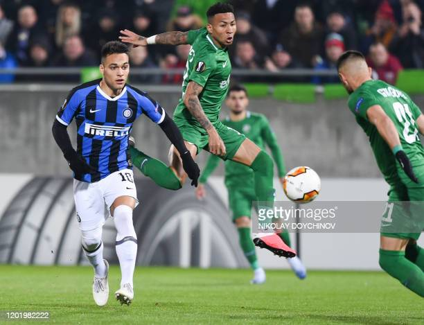 Ludogorets Razgrad's Madagascar midfielder Anicet Abel fights for the ball with Inter Milan's Argentinian forward Lautaro Martinez during the UEFA...