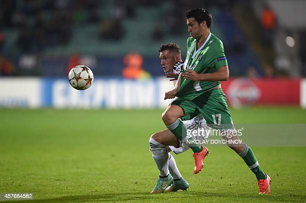 Ludogorets Razgrad's midfielder from Spain Dani Abalo vies for the ball with Basel's midfielder Taulant Xhaka during the UEFA Champions League Group...