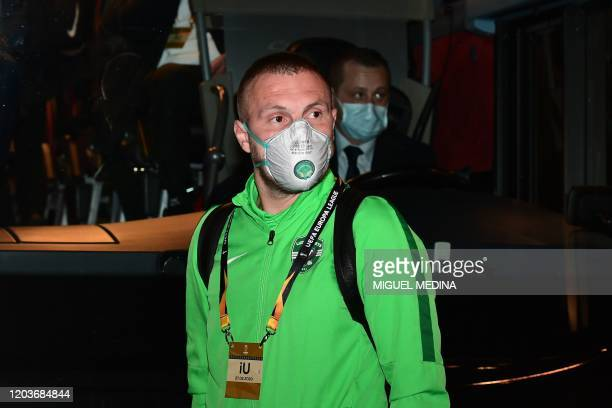 Ludogorets' Romanian defender Cosmin Iosif Moti wears a face mask as a safety measure against the COVID19 the novel coronavirus as he boards the bus...