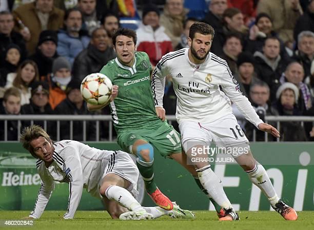 Ludogorets' Spanish midfielder Dani Abalo vies with Real Madrid's Portuguese defender Fabio Coentrao and Real Madrid's defender Nacho during the UEFA...