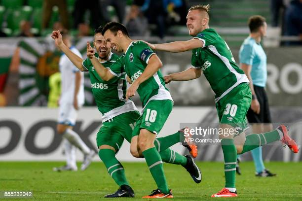 Ludogorets's Bulgarian midfielder Svetoslav Dyakov celebrates with teammates after scoring a goal during the UEFA Europa League Group C football...